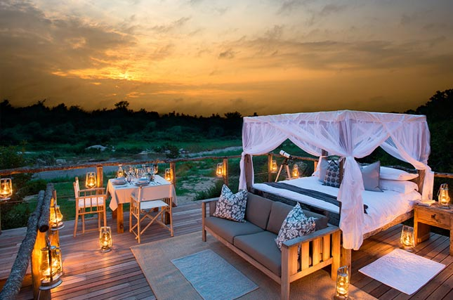 A four poster bed under the starry African sky - perfect for a romantic safari escape.